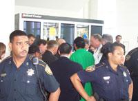 Police escort officials into the Astrodome