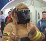 A conference goer tries on some fire-fighting equipment