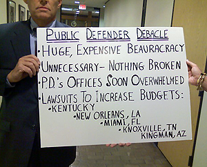 poster against public defender plan