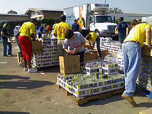 image of volunteers unpacking boxes