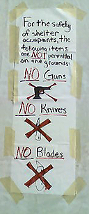 image of tent city safety sign that reads: no guns, no blades, no knives