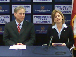 image of Lea Bird speaking at a press conference with Abbott