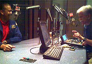 image of Pat Hernandez interviewing former astronaut Bernard Harris at the KUHF studio