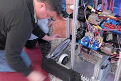 MAES students works on a robot