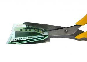 image of scissors' cutting cash