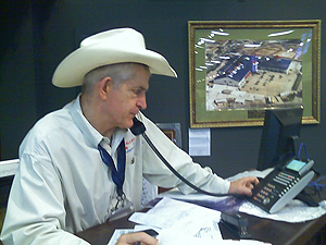image of Jim McIngvale answering the phone