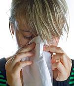 woman holding a Kleenex
