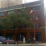 A nearly century old building downtown near Minute Maid Park is spared, for now, after Harris County Commissioners delay a vote on its demolition. As Pat Hernandez reports, county leaders are ready to replace the building with a parking garage, but preservationists are hoping to hold-off the wrecking ball.