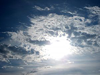 see sun poking out from behind clouds
