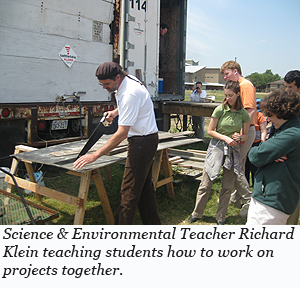 Science & Environmental Teacher Richard Klein teaching students how to work on projects together