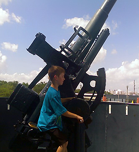 boy playing with turret