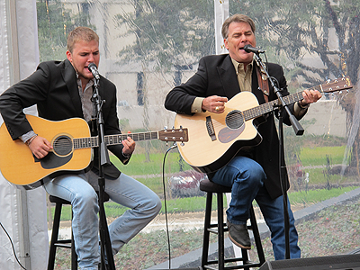 Kevin Black, joined by son Colton, plays a song