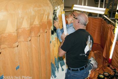Technicians examining stringers