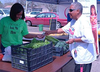 Arga Bourgois selling vegetables with Sunshine Foods