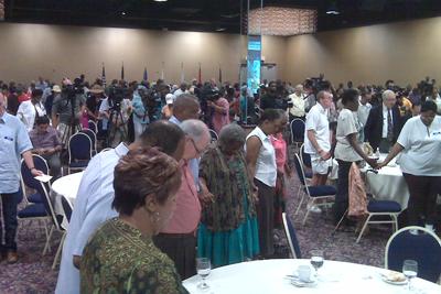 Seniors pray with Pelosi