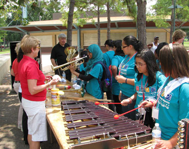 campers take part in an instrument petting zoo