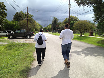 Houston health department workers Rosalind Augustine, left, and Sharisa Daniel walking