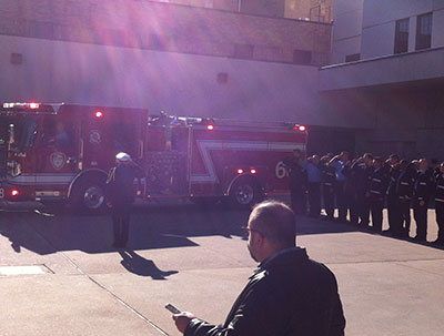 Capt Bill Dowling leaves in fire engine