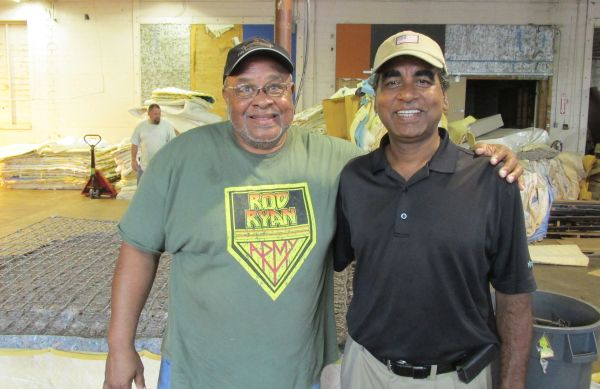 Houston Furniture Bank Executive Director Oli Mohammed, right,  and mattress recycling manager Solomon Henry.