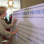 AmeriCorps pledges money and volunteers to put the Bush literacy plan in action.