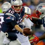 """New England Patriots quarterback Tom Brady said he didn't give the game balls a thought during Sunday's win over the Indianapolis Colts. """"I didn't alter the ball in any way,"""" he said."""