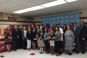 group of students, educators and mayor