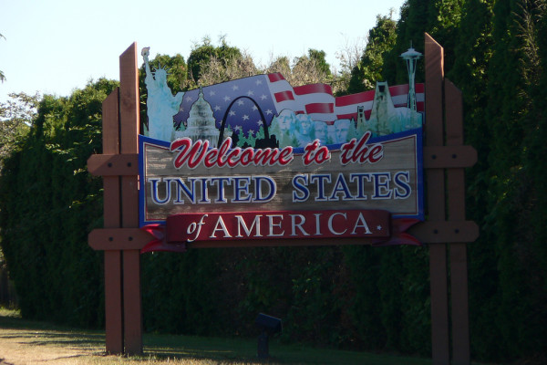 sign reads, welcome to the United States of America