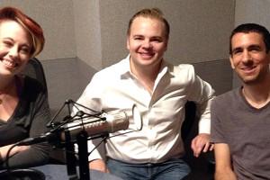 Three musicians pose for a photo in a radio studio