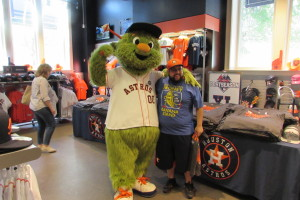 "Astros mascot ""Orbit"" poses for pictures with fans at the team shop at Minute Maid Park."